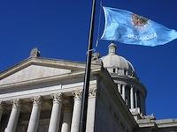 Oklahoma capitol and flag